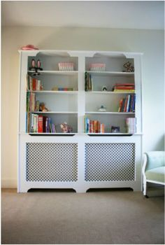 radiator cover bookshelf...I would do a tv center instead...great idea for the living room radiator!