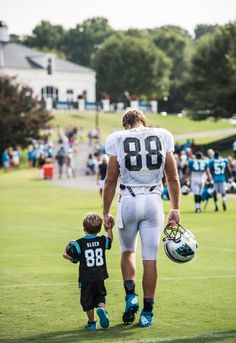 TE Greg Olsen (88) and son Tate after practice at training camp 8/5/14