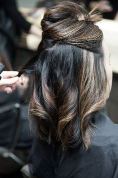Layering the curls with a flat iron