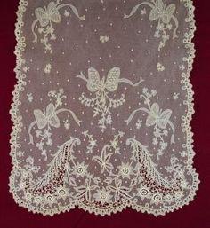 Beautiful rectangular shawl of Carrickmacross applique on machine net from the 1/15/2017 Ebay Alerts.