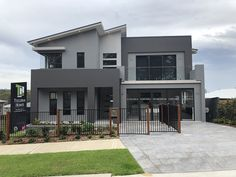 Tullipan Homes display at Warnervale - colour design by Samantha Bacon Flat Roof House, House Siding, House Paint Exterior, Exterior House Colors, Facade House, Modern Bungalow Exterior, Small House Exteriors, Outdoor House Colors, Exterior Paint Color Combinations