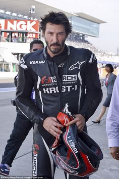 Need for speed: Keanu Reeves was pictured at the Suzuka Circuit in Japan test-riding his custom KRGT-1 on Saturday