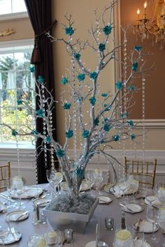 Swanky centerpiece of silver tree with tiffany flowers and crystals. The post Elegant Christmas Table Centerpieces To Your Holiday Decor appeared first on Dekoration. Branch Centerpieces, Silver Centerpiece, Christmas Table Centerpieces, Wedding Centerpieces, Wedding Decorations, Christmas Decorations, Holiday Decor, Tiffany Centerpieces, Butterfly Centerpieces