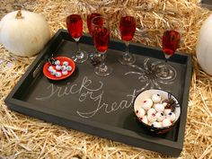 Serve Halloween guests in style with this easy-to-create and totally customizable chalkboard tray.