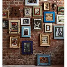 would love to have a wall just like this in our home one day! with pictures of us and our family of course.