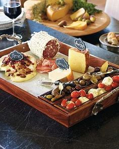 Serve up delectable cheeses, olives and much more atop the Tuscan Cheese Serving Tray Set that includes three premium utensils to help your entertaining even easier.