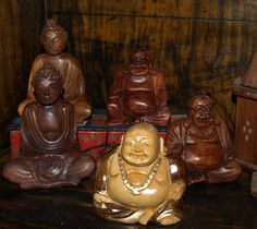 Carved wooden Buddhas and Quan Yins