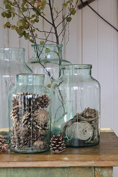 ~~ Staggered glass jars filled with pine cones and dried flowers make a great vignette for a closet shelf or island. ~~ : ~~ Staggered glass jars filled with pine cones and dried flowers make a great vignette for a closet shelf or island. Vibeke Design, Deco Nature, Nature Decor, Deco Floral, Christmas Decorations, Holiday Decor, Holiday Crafts, Farmhouse Chic, French Country Farmhouse
