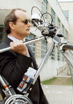 Bill Murray- Sunglasses - walking holding his bicycle up, rushmore , February 2015