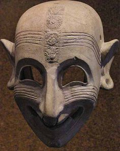 "Phoenician grinning mask (5th century BCE) found in San Sperate, Sardinia, on display at the National Archaeological Museum of Cagliari. It's an example of the ""sardanios ghelos"", the sardonic laugh mentioned by Homer and others in ancient times."