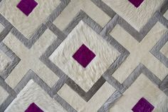Glamorous rug shown in cream, silver & magenta