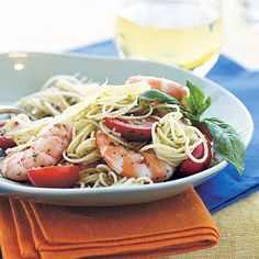 Pesto Shrimp Pasta - 4 simple ingredients combine to create heaven on a plate.   (prep 8 min, cook 15 min) Ingredients: Shrimp (1 ¼ lbs) Angel hair pasta (4 oz) Pesto Grape tomatoes Fresh parmesan cheese
