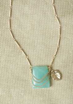 Natural Treasures Necklace 14.99 at shopruche.com. This delicate gold-toned necklace features a milky turquoise stone draped in simple chains and accompanied by a dainty leaf pendant.18