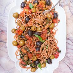 Dolce Vita Puttanesca | 4 garlic cloves, diced 1/2 red chilli, deseeded and chopped 8 cherry tomatoes, halved 80g black olives, half chopped 80g green olives, half chopped 2 tbsp capers 1/2 glass of dry white wine 400g tinned plum tomatoes bunch of basil, roughly chopped  Finely grated zest and juice of 1 unwaxed lemon 1 tbsp aged balsamic vinegar 160g dried wholegrain spelt spaghetti sea salt and freshly ground black pepper