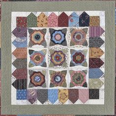 Raid your stash to make this table mat and matching mug mats. Add a personal  touch by finishing this project with large, hand-quilted stitches.