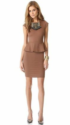 8765b65915c10 In Defense of Peplum  The Trend Everyone Loves to Hate