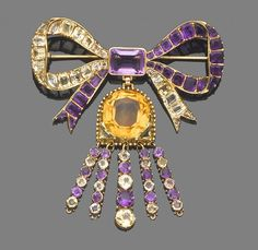 :  A topaz, amethyst bow brooch