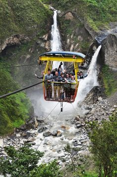 Cable car over a waterfall in Banos. #Ecuador