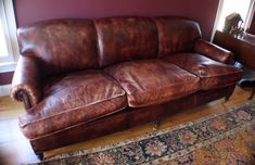 """This is an authentic George Smith distressed leather couch,purchased thru the NYC studio on Spring Street. Leather is colored a rich """"terracotta"""" brown color with """"distressed"""" design."""