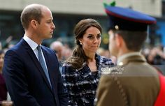 Britain's Prince William (L) and his wife Catherine, Duchess of Cambridge attend a paving stone ceremony for Victoria Cross recepients at the Manchester Cenotaph in Manchester on October 14, 2016. / AFP / POOL / Darren STAPLES