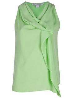 Acid green silk sleeveless top from a draped neckline, folds to the front and a side ruffle.
