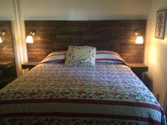 We made our own headboard from pallet wood, Ikea wall lamps and dark walnut stain. Headboard has built in night stands for our small bedroom with a king sized bed!