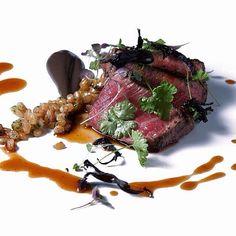 Black angus filet, herb salad, toasted farro, and black trumpet mushroom purée by @acquerellosf #TheArtOfPlating