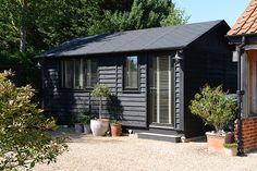 Black-garden-room-by-Smart-Garden-Offices - Garden Shed Smart Garden Offices, Garden Office Shed, Cabana, Black Shed, Black Cladding, Contemporary Garden Rooms, Contemporary Sheds, Painted Shed, Garden Cabins