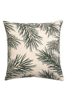 CONSCIOUS. Poszewka na poduszkę z niebielonej ekologicznej bawełny z nadrukiem wzoru świątecznego. Kryty suwak.