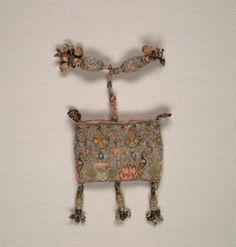 Purse, early 1600s  England, early 17th century  embroidery; silk and silver filé on linen ground, Overall - h:11.43 w:10.16 d:6.99 cm (h:4 1/2 w:4 d:2 3/4 inches). Gift of The Textile Arts Club 1944.283