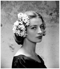Capucine with flowered hair ornament worn on the side, photo by Yale Joel, 1950s