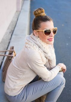 Classic comfort - A chic bun paired with a cozy sweater.