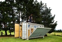 """""""Port-a-Bach"""" tiny container home complete with retractable deck in New Plymouth, New Zealand. Photos by Paul McCredie. Designed by Atelierworkshop."""