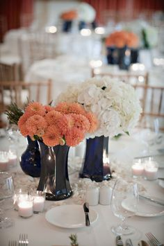 Navy vases, peach flowers. Peach isn't one of our colors, but this is cute.