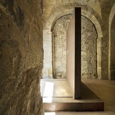 Metal sliding door. When open it acts as a buffer when entering the space. Basilica paleocristiana di San Pietro in Siracusa by Emanuele Fidone.