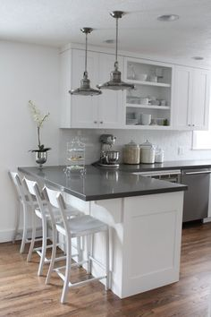 White cabinets, gray counters, wood floors, but I would add a color on the wall and a back-splash with a little color too. by julian.chiang #whitecabinets