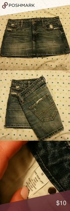 American Eagle distressed Jean skirt Standard back pocket with AE logo, distressing throughout. Worn once. Zipper and button closure. Women's size 10 American Eagle Outfitters Skirts Mini