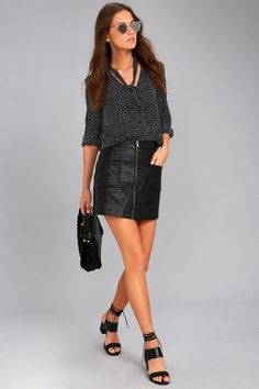 An on-trend outfit starts with the Jack by BB Dakota Cohen Black Vegan Leather Mini Skirt! Sleek vegan leather forms this high-waisted skirt with an A-line silhouette, quilted front patch pockets, and exposed gunmetal front zipper.