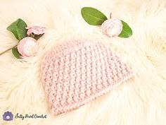 This free textured crochet hat pattern is simpler than it looks! The First Blooms Beanie exudes warmth and cheer that will tide you over until you finally see your first flowers blooming. Free Crochet Hat Pattern at Salty Pearl Crochet. Baby Beanie Crochet Pattern, Crochet Kids Hats, All Free Crochet, Crochet Patterns, Knit Hats, Hat Crochet, Irish Crochet, Pearl, Sheepskin Rug