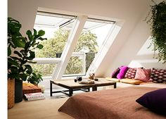 the velux cabrio is installed like a skylight and can be opened in two ways tra - frieda Garage Floor Tiles, Frosted Window Film, Garage Storage Solutions, Windows System, Roof Window, Attic Spaces, Window Cleaner, Skylight