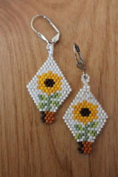 Items similar to Sunflower Earrings, Handmade using Delica Seed Beads on Etsy Bead Jewellery, Seed Bead Jewelry, Seed Bead Earrings, Seed Beads, Lovisa Jewellery, Body Jewelry, Silver Earrings, Beaded Earrings Patterns, Seed Bead Patterns