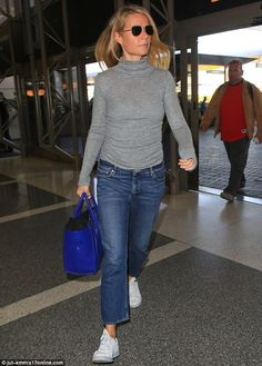 In a hurry: Gwyneth Paltrow looked stylish at LAX airport on Thursday while wearing a grey turtleneck, boyfriend jeans and white sneakers