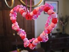 Beads and pipe cleaners make a sweet child-made Valentine's Day heart ornament.
