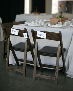 Reception: Chair Swags  The DIY signs that adorned the backs of Andi and Carissa's chairs were printed at home. They used the Travelling Typewriter typeface