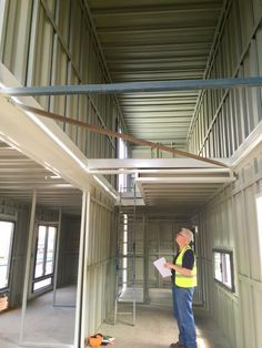 Inside the steel structure of my shipping container house - looking back up into the loft which opens onto the top deck.