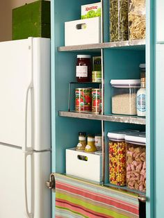 Using fabric as a cabinet door can soften a boxy feel. A swing arm bar makes the shelving easy to access.