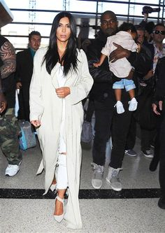 Kim Kardashian West caught a flight out of LAX Airport in Los Angeles, Calif., with her husband Kanye West and their daughter North West on April 7, 2015.