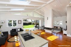 The living and kitchen area is open-plan, using furnishings to break them into cosy sections. The walls are painted in Resene Double White Pointer and Resene Half Napa. http://www.habitatbyresene.co.nz/blayne-talents-winning-home