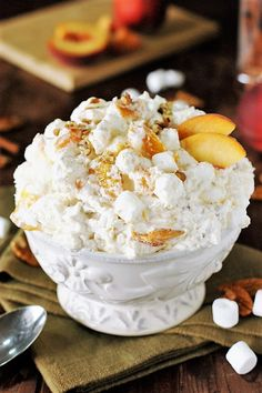 Peach Fluff Salad ~ A bowlful of creamy peachy comfort! Made with peach pie fill… Peach Fluff Salad ~ A bowlful of creamy peachy comfort! Made with peach pie filling, it's quick & easy to prepare … and makes one fabulously tasty fluff. Dessert Salads, Fruit Salad Recipes, Dessert Recipes, Fruit Salads, Jello Salads, Pie Recipes, Yummy Recipes, Fluff Desserts, Just Desserts
