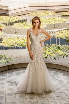 Jazzy by Enzoani - the perfect figure flattering fit and flare champagne wedding gown for hourglass shapes.